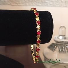 Red and Gold Heart Bracelet Simulated ruby red crystals. Gold tone bracelet with lobster clasp. No Trades Jewelry Bracelets