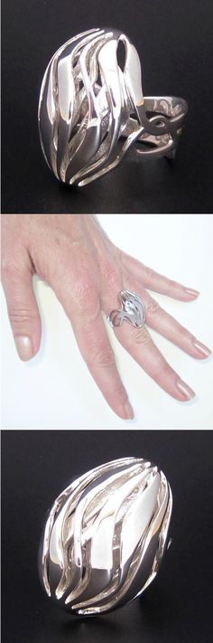 Intricate & stylish multi-layered silver ring designed by the artist, MG.  Individually produced using 3D printing.