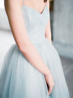 Bohemian tulle wedding dress Tara features a sweetheart neckline bodice in gray blue color with open, lace up back detail and an a-line tulle skirt. The bodice is made of beautiful velvety material with embossed pattern covered with Chantilly lace. It is fully boned to provide