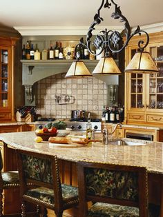 Beautiful French Country Kitchen by Rinfret, Ltd.