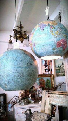 7 Cool Ways to Decorate with Vintage Maps and Globes: Globe Pendant Lights Tip: Punch holes in the places you've visited, allowing light to filter through in unexpected places while adding another layer to your decorative story.