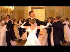 Andre Rieu live at Schönbrunn Vienna 2006 - Wonderful dancing, waltzes in the grand ballroom, and also waltzes done on ice skates at ice show outdoors, big gowns.   Magnificent! Love it!  About 10 minutes long.
