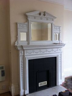 Antique cast iron Regency style fire surround/fireplace with matching mirror