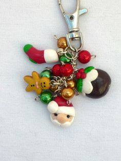 Handmade Christmas keyring or bagcharm decorated with handmade polymer clay charms