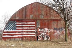 United we stand -- I love the shape of this old barn as well as the patriotic message!