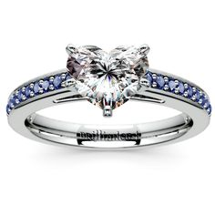 Blissful in blue: We all know how beautiful diamonds and sapphires look together... And while some of you love your pieces all glam and huge, others may prefer am understated, elegant diamond-sapphire mix. Meet the Cathedral Sapphire Gemstone Engagement Ring in Platinum, featuring a stunning Heart-cut center diamond!   http://www.brilliance.com/engagement-rings/cathedral-sapphire-gemstone-ring-platinum