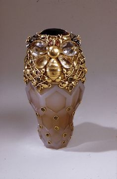 Gold, agate, yellow sapphires, dementoid garnets, red garnets, and amethyst Tiffany perfume bottle