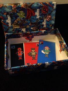 Superhero writing box & notebooks to encourage boys writing.