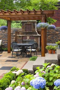 "Great place to hang out when You have a small party or people over! Wonderful ""Backyard beauty - a pergola, fireplace, and wrought iron seating set make for a charming garden spot."""