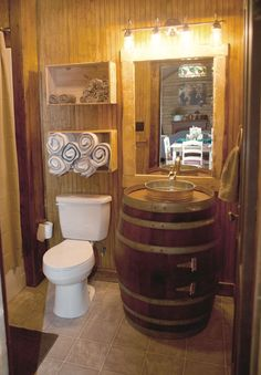 Crate for the towels, barrel and tin bucket for the sink.  Top it off with mason jar light fixtures.