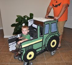 John Deere cardboard tractors attached to stroller for Halloween