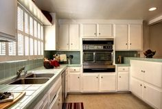 Eclectic Kitchen with cupboards