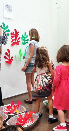 Children painted cut-outs of the leaves then each decided where to place his/her leaf on the large sheet of paper.