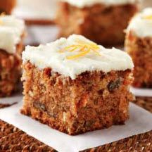 Serve this delicious carrot cake topped with a fluffy cream cheese frosting at your next family gathering.