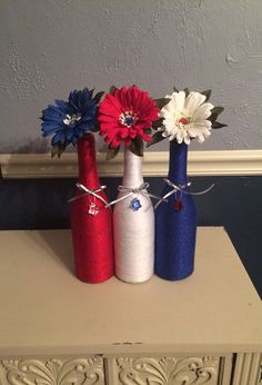 Patriotic Red, White and Blue Wine Bottles with Flowers