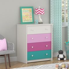 The Kaleidoscope 4-Drawer Bedroom Chest features a white stipple, urban pink, raspberry and turquoise drawer to fit in with your child's style.. Made in USA.