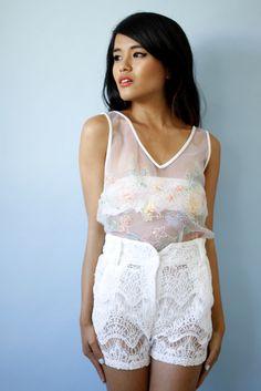 Olivia Lopez wearing Les Fleurs Mesh Tank