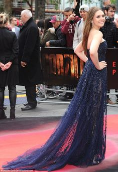 Eye-catching: The actress couldn't be missed in the midnight blue dress which was strapless and featured a train