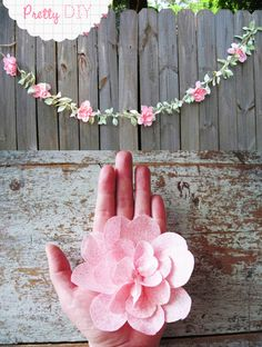 diy Fabric Flower Garland would be very sweet in a little girl's room or for wedding decorations Link to tutorial:  http://www.freeprettythingsforyou.com/2011/06/pretty-diy-fabric-flower-garland/