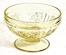 These are amber Depression Glass sherbets in the Sharon pattern. They were made by Federal and are in good condition with no chips or cracks.