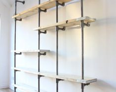 Wesley Scaffolding Boards and Dark Steel Pipe Wall by inspiritdeco