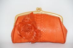 Orange python with floral embellishment
