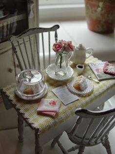 Lovely set up; a piece of cake, a cup of tea, roses, and a good magazine!