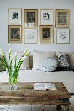 Picture frame layout, table, vase and flowers, pillows....