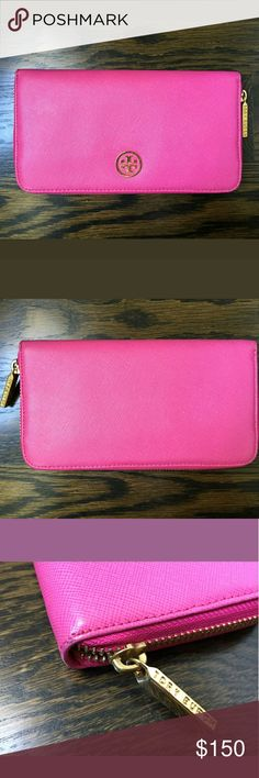 Authentic tory burch pink saffiano wallet 100 percent authentic tory burch pink saffiano wallet. Gently used and is in great shape. Minor wear on the corners but nothing too noticeable!  Sorry no trades! Will ship same or next day. Will accept reasonable offers, PLEASE DO NOT SEND LOWBALL OFFERS! ! Tory Burch Bags Wallets