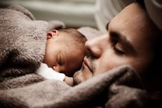 adorable daddy and newborn