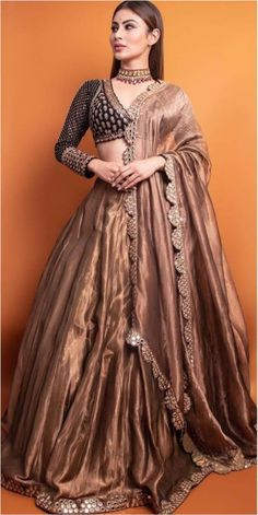 Diva Charm : Mouni Roy makes a ravishing statement in a black-copper embroidered lehenga from Vvani by Vani Vats . WhatsApp us now for personal shopping experience! Party Wear Indian Dresses, Party Wear Lehenga, Indian Gowns Dresses, Indian Bridal Outfits, Red Lehenga, Dress Indian Style, Indian Fashion Dresses, Indian Designer Outfits, Indian Wear