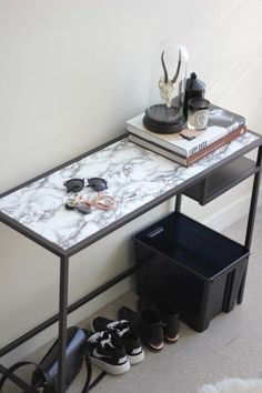 IKEA + Contact Paper = DIY Magic. This Vittsjo table from Syl and Sam got dressed up with a little marble contact paper.