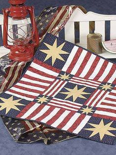 Stars and stripes combine to make a patriotic table quilt. Get this free quilt pattern and make your table look spectacular.