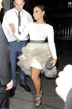 Fit for a princess: The 22-year-old singer added glittery heels and a matching clutch bag ...