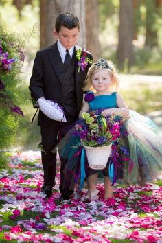 This is a flower girl dress but it would make a really cut peacock costume
