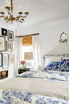 Rather than edit down a large collection of artwork, this California homeowner created a gallery wall that stretches from the crown molding to the baseboards, making room for every cherished piece.