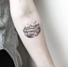 Circular landscape tattoo by Maria Fernandez