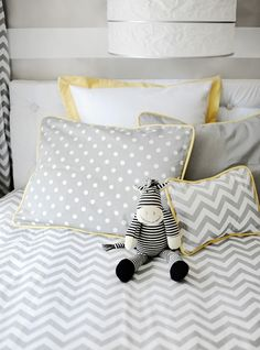 Cute gray and yellow bedding with a chevron print.