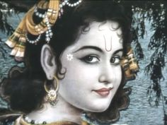 """""""Sri Krishna's eyes are long like petals of a blooming lotus, and His very charming lotus-like face is made all the more charming by His extremely beautiful and sweet, nectarous smiles. His profuse curling locks look delightful with their decoration of a proud peacock's tail-feather. Let Him, the embodiment of all effulgence, forever shine within my heart."""