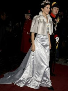 2009  Mary totally killed it with this icy blue dress and fur topped off with Danish rubies, though. Best one yet!The Danish Royal Family New Year's Day Banquet