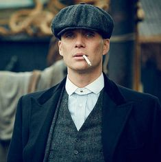 326634271e6 Thomas Shelby wearing a grey Donegal Tweed 8-panel flat cap - Peaky ...