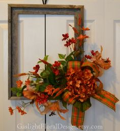 "Rustic Living wreath is full of warmth and uniqueness. A full hydrangea bloom captures your eye and the darling tiger lilies bring back memories of the fall season. This flower arrangement is attached to an 18"" rustic frame.  DIMENSIONS 24x20x8.  $112.00"