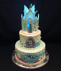 "Frozen Ice Castle Cake - 6"" & 8"" buttercream. Fondant and gumpaste accents. Also hard candy 'ice'. Mini battery-operated light inside castle."