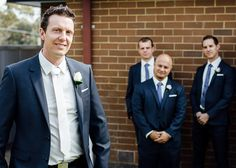 Groom and groomsmen outside with a brick wall in the background #wedding #photography #melbourne #weddingphotography #ballarareceptions