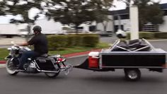 """This is so perfect for motorcycle traveling! The """"Solace"""" is a pop-up camper trailer that hooks right up to the back of your motorcycle. Check out the video below and let us know what you think of this cool trailer. The trailer handles slow, tight turns and the pop-up camper has plenty of room. Can…"""