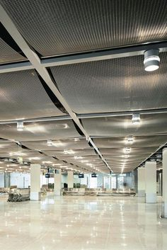 "Architectural Wire Mesh ceiling at Airport Düsseldorf, Germany. ""Simply brilliant how exclusive design, fire protection and easy maintenance can be combined"" J.S.K. Architects."