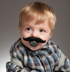 Little plastic mustaches that can be clipped on to a baby's pacifier.  Amazing.