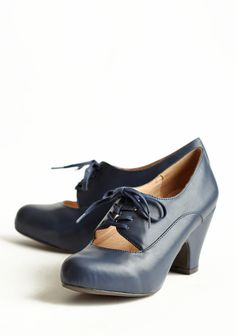 Tyra Navy Oxfords Pumps By Chelsea Crew 64.99 at shopruche.com. These adorable navy pumps feature an oxford style lace-up  closure and an alluring front cutout. Finished with a subtly upturned  toe for a feminine fit, these pumps pair well with all of your favorite  dresses and skirts.Leather upper,...