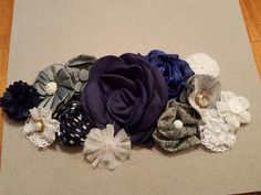 Maternity Sash - Glue flowers to stiff felt and tightly cut around back of overall arrangement. Glue to tie ribbon along with any other accents