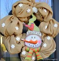 DIY burlap wreath with tin snowman and Dollar Store snowflakes via Worthing Court blog